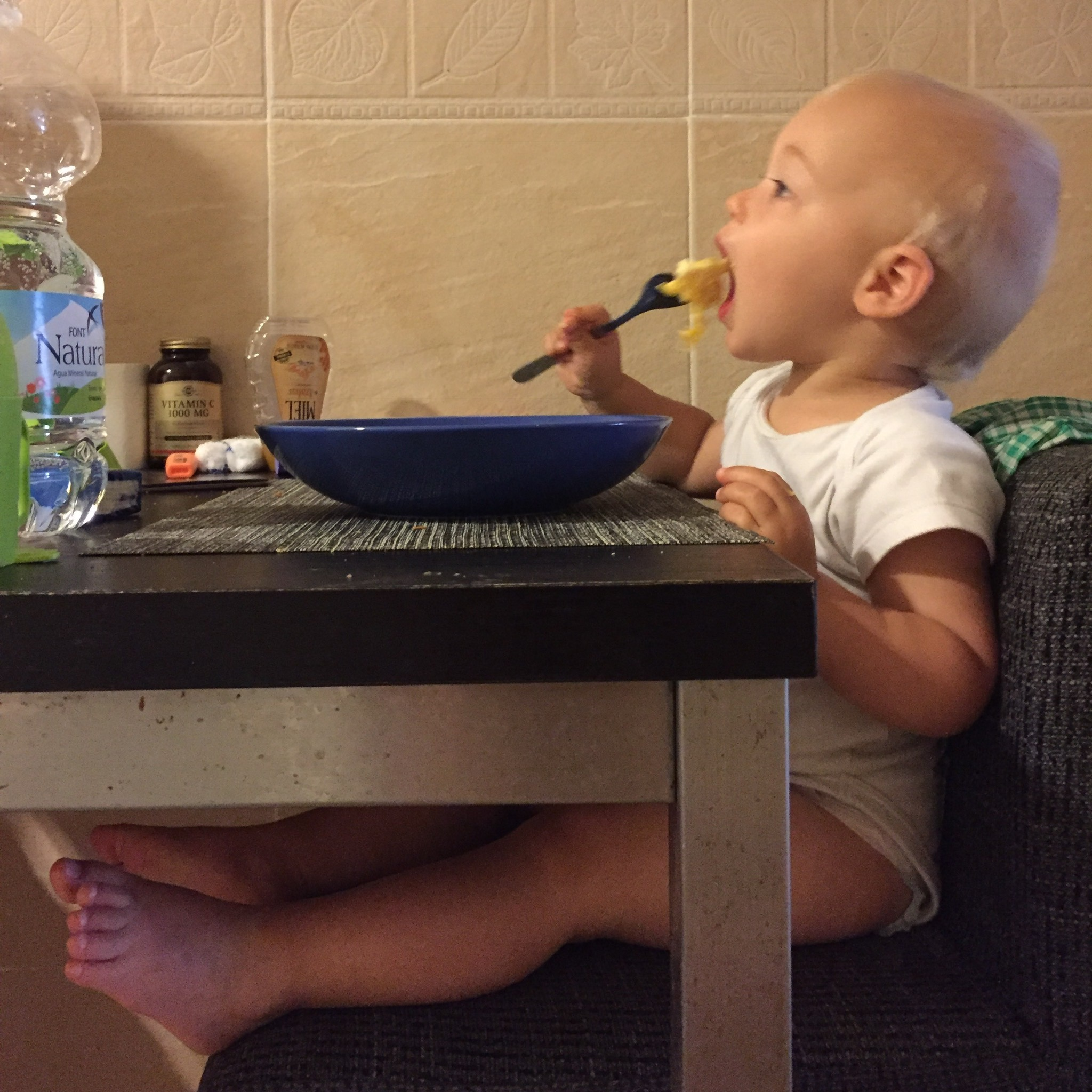 Oliver eating eggs with fork at 15 months